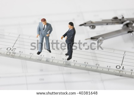 Figures of the businessmen who stands as the side of a compass.