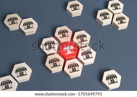 Figures with store symbols are combined into an assembly. Franchise commercial concession concept. Investing in asuccessful business model. Building a business empire. Expansion and competitive growth Сток-фото ©