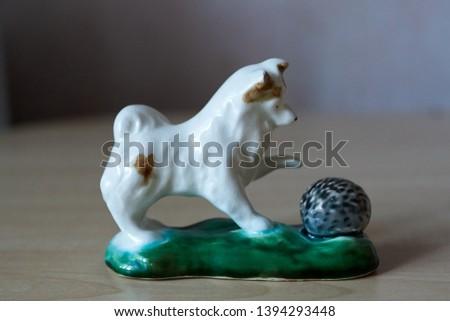 Figurine doggie with a hedgehog #1394293448