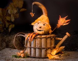 Figurine made of autumn materials like gourds, leaves, acorns