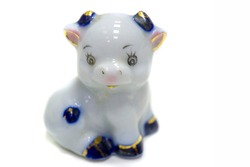 Figurine of a cow. ceramics porcelain. Flea market. Folk crafts Gzhel, Small size. Macro photography. isolated on white background