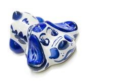 Figurine of a dog. ceramics porcelain. Flea market. Folk crafts Gzhel, Small size. Macro photography. isolated on white background