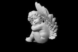 figurine: white angel on a black background, Valentine's Day, New Year