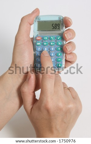 Figuring costs on calculator.