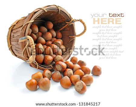 Filberts in the basket isolated on white background