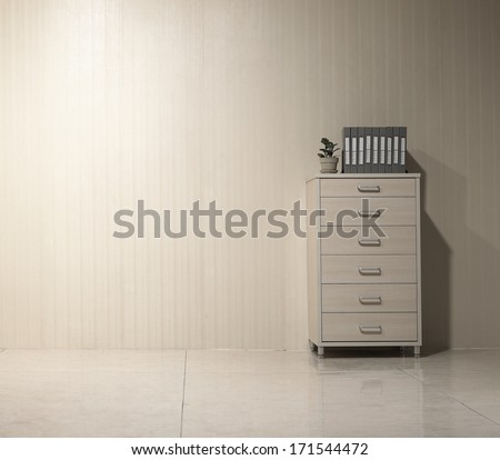 File cabinet and folders, in the clean office