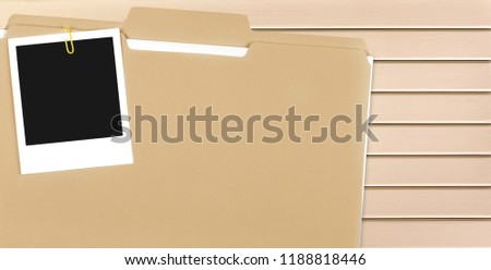File Folder with Documents and Blank Polaroid #1188818446