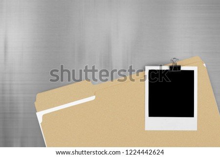 File Folder with Documents and Blank Polaroid #1224442624