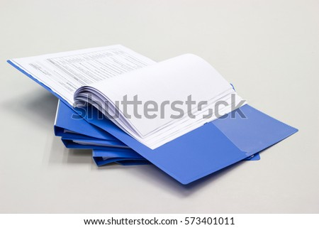 file folder with documents and documents. retention of contracts on the table