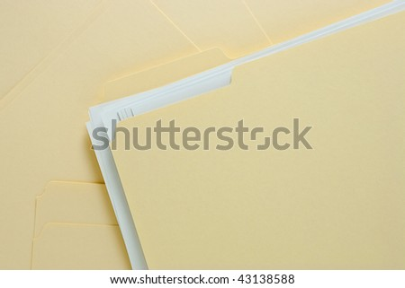 File Folder with Paper on Messy Pile