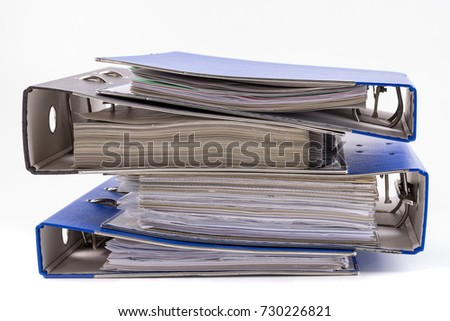 File folders or ring binders full with office documents isolated on white. #730226821