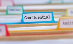 File folders with a tab labeled Confidential
