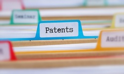 File folders with a tab labeled Patents