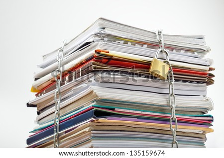 File stack locked with chain and padlock