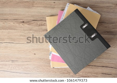 File Stack top view, file folder pace on wood desk background