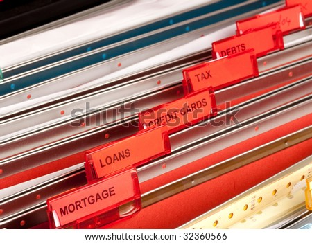 Files in a filing cabinet showing debt related labels