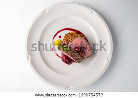 Filet mignon Beef, or Pork. Grilled young calf tenderloin with berries, mashed potatoes. Banquet festive dishes. Fine dining restaurant menu. White background.