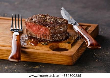 Filet Mignon Steak on wooden board on black background Сток-фото ©