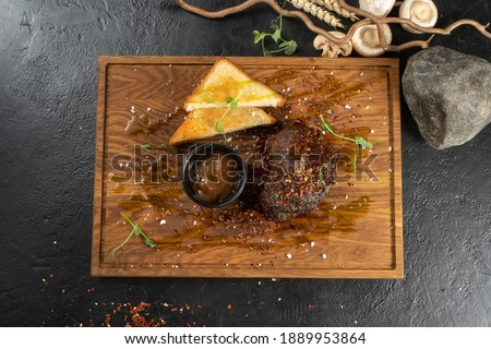 Filet mignon steak with demi-glace sauce. A hot main course with beef meat, toast and sauce. Photo stock ©