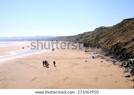 FILEY, NORTH YORKSHIRE, UK. APRIL 21, 2015.  Early morning with the sun glittering on the sands at Filey in North Yorkshire, UK.