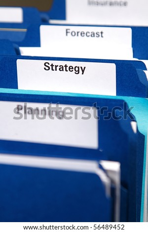 Filing cabinet full of business folders and documents - stock photo
