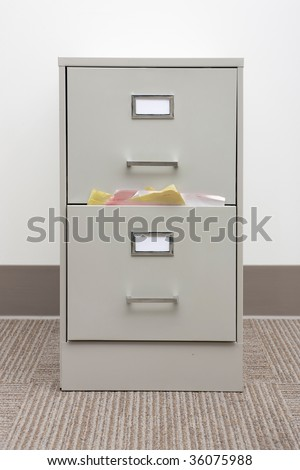 filing cabinet stuffed with papers