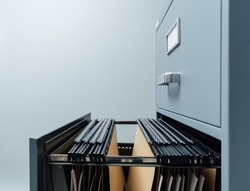 Filing cabinet with open drawer and files inside: data storage and archives