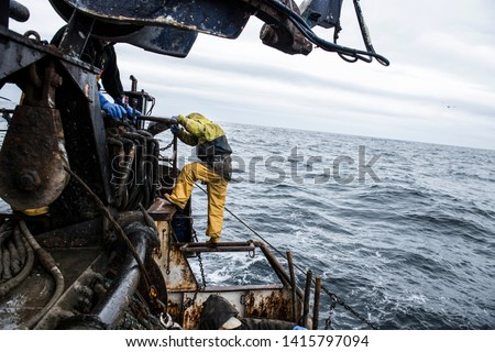 Filipino fishermen working on Scotland's wild North Sea.  #1415797094
