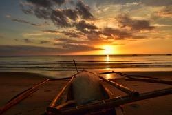 Filipino fishing boat at sunset on the sugar beach, Fishing boat on the beautiful sandy coast of the negros island
