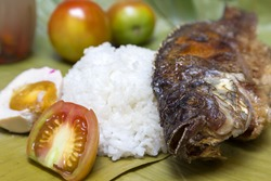 Filipino traditional dish: fried philippine tilapia fish with rice