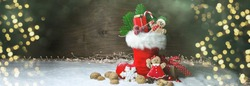 Filled Nicholas boot with gift and gingerbread man - Christmas background with golden bokeh lights
