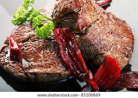 Fillet mignon red wine sauce with chili