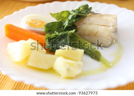fillet of baked cod with egg and vegetables