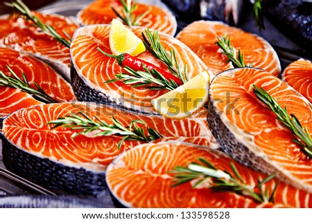 Fillet of salmon served with lemon and rosemary
