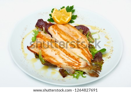 Fillet of sea bass grilled with rocket and lemon,  isolated on white background #1264827691