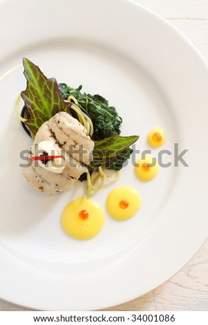 fillet of white fish, an appetite dish. Garnish with caviar and bay leave, saucing with yellow sauce.