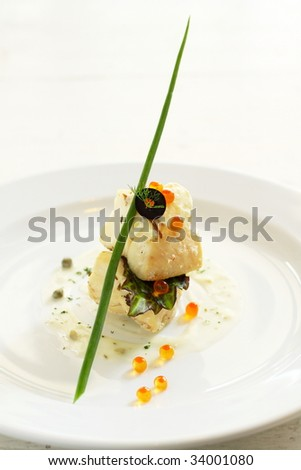 fillet of white fish, an appetite dish. Garnish with caviar and spring onion, saucing with white sauce.