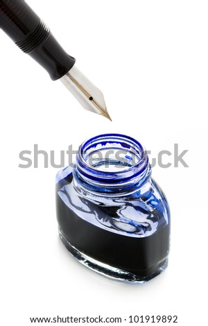 filling a fountain pen with blue ink from a bottle