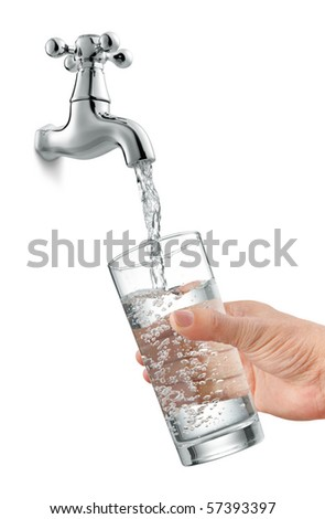filling a glass of water from tap - stock photo