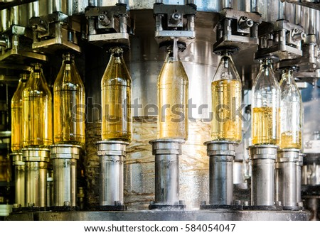 Filling bottles with juice #584054047