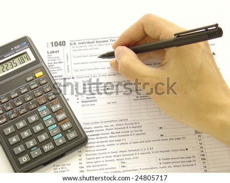 Filling federal tax forms with a calculator and a pen