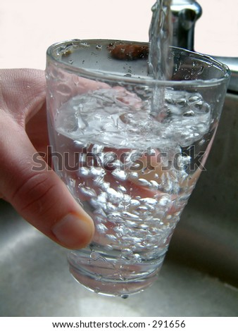 Filling glass with water.