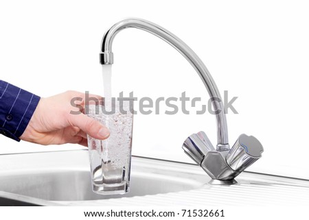 filling in glass of drink  water from faucet