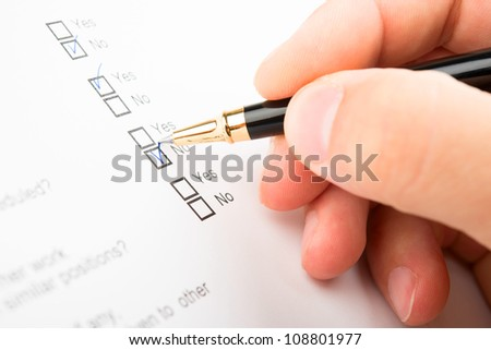 Filling of questionnaire a person by a ball point pen