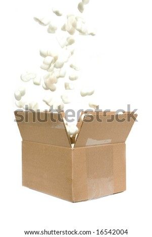 filling shipping peanuts in a box isolated against white background