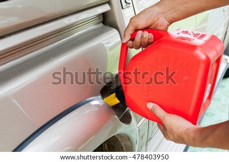 Filling spare fuel in car #478403950