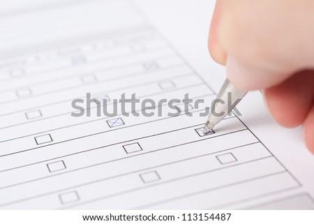 Filling the form closeup studio shot
