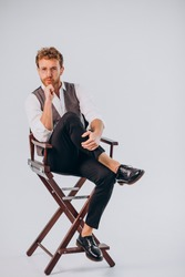 Film director sitting in chair and looking into camera