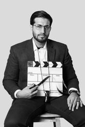 film director with a clapper board a film reel and director view finder movie director