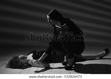 Film noir. Detective woman investigating the crime scene  #532826473
